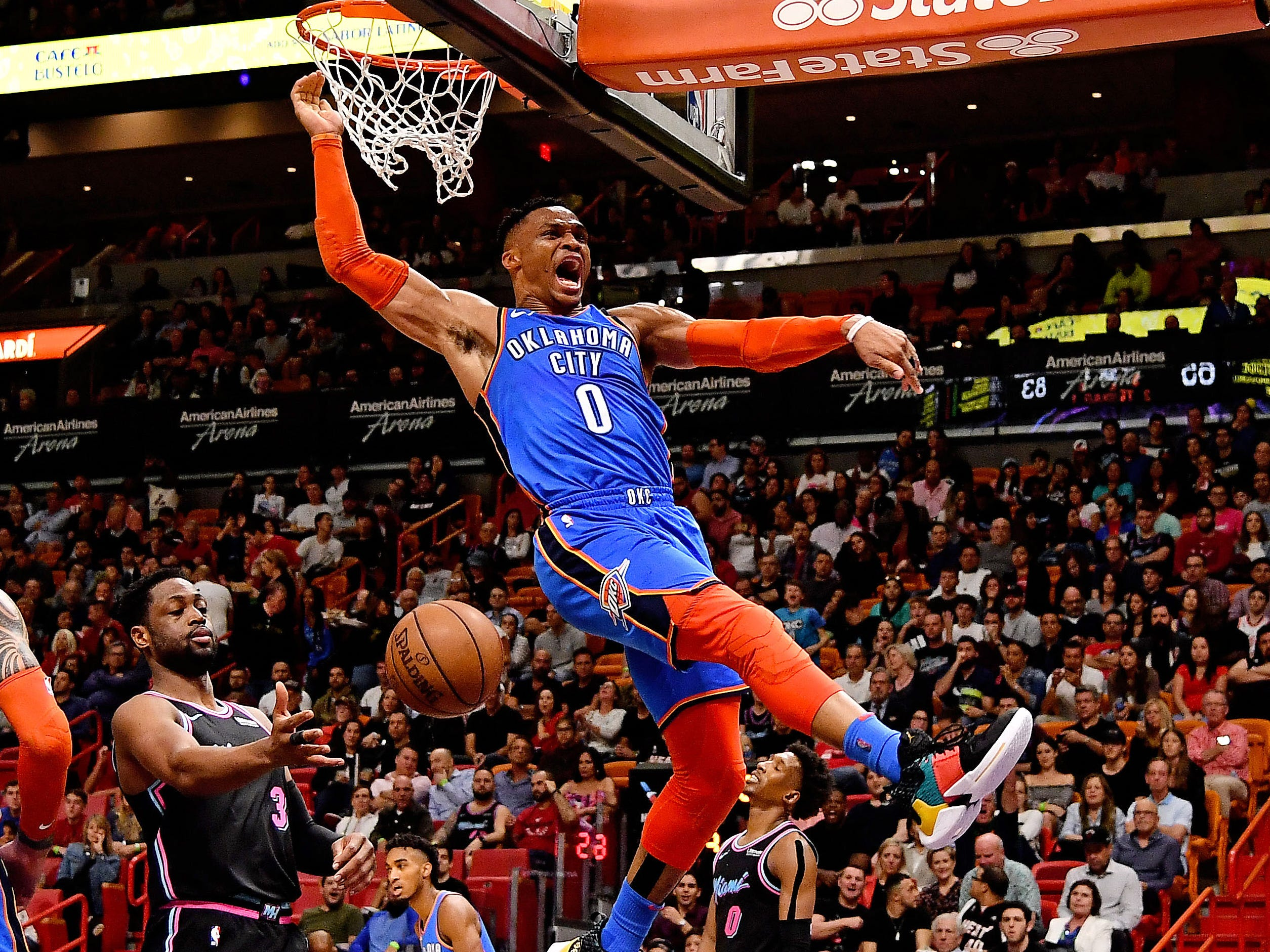 Feb. 1: Thunder guard Russell Westbrook finishes the big two-handed slam against the Heat in Miami.