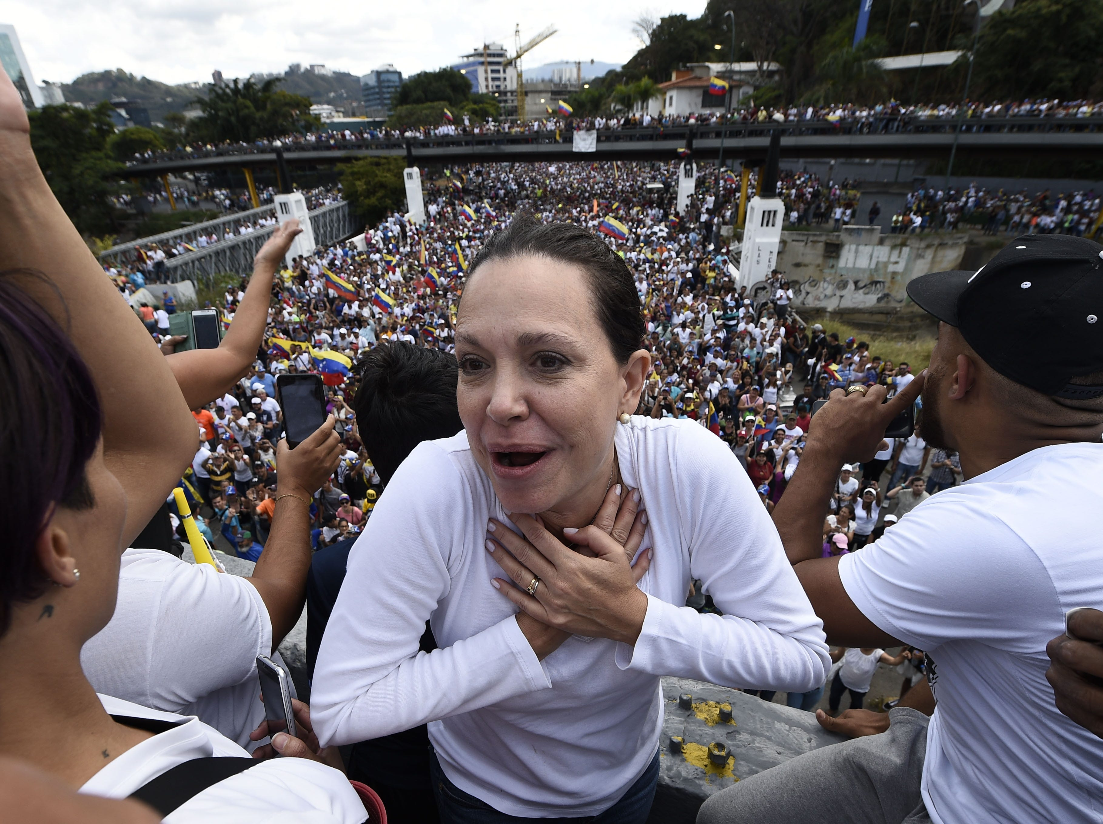 Venezuela's radical opposition leader Maria Corina Machado gestures during a gathering with Venezuelan opposition leader Juan Guaido and thousands of supporters, in Caracas on Feb. 2, 2019. Tens of thousands of protesters were set to pour onto the streets of Caracas to back self-proclaimed acting president Guaido's calls for early elections as international pressure increased on President Nicolas Maduro to step down. Major European countries have set a Sunday deadline for Maduro to call snap presidential elections.