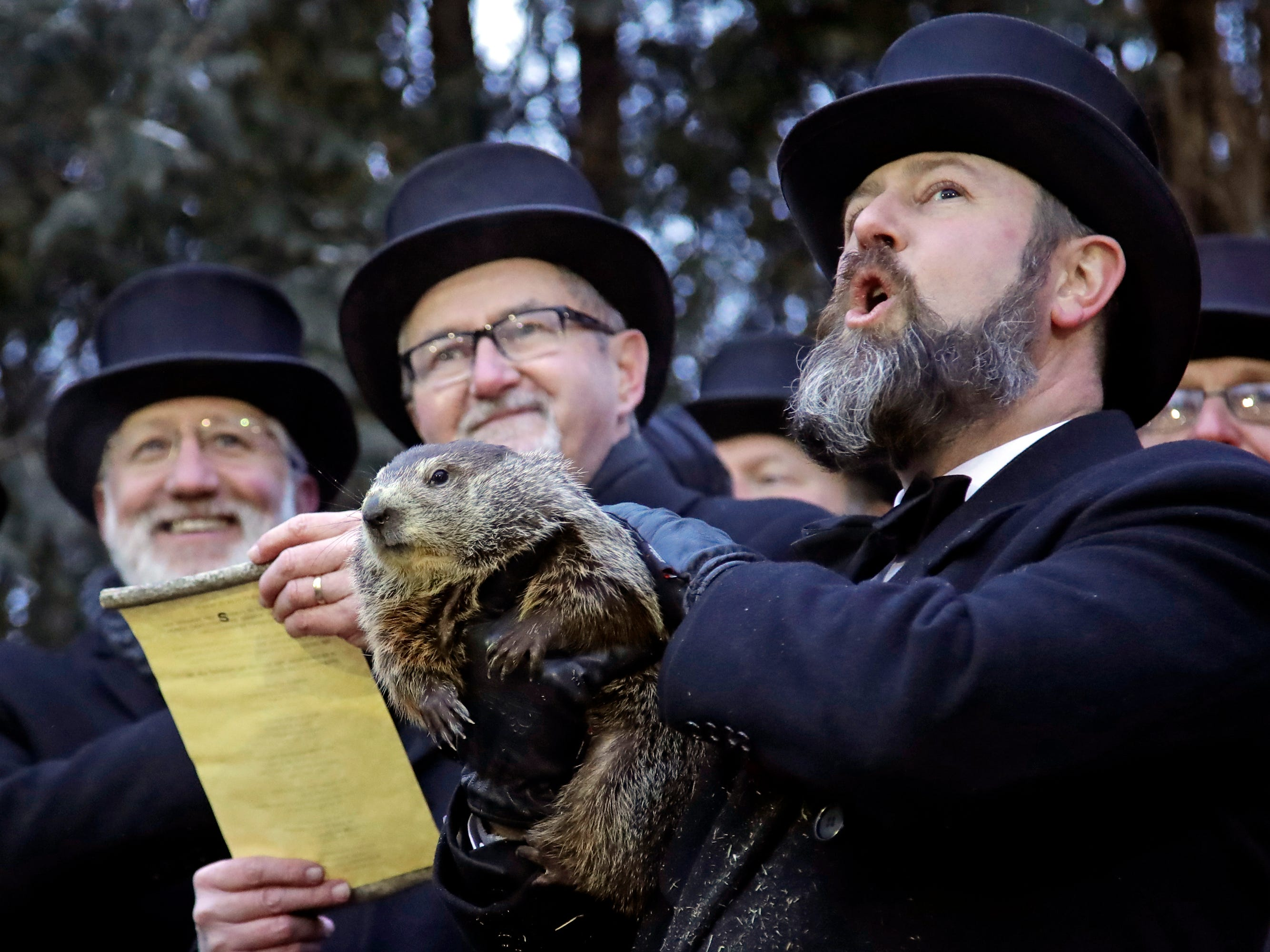Groundhog Club co-handler Al Dereume, right, holds Punxsutawney Phil, the weather prognosticating groundhog, during the 133rd celebration of Groundhog Day on Gobbler's Knob in Punxsutawney, Pa. Saturday, Feb. 2, 2019.