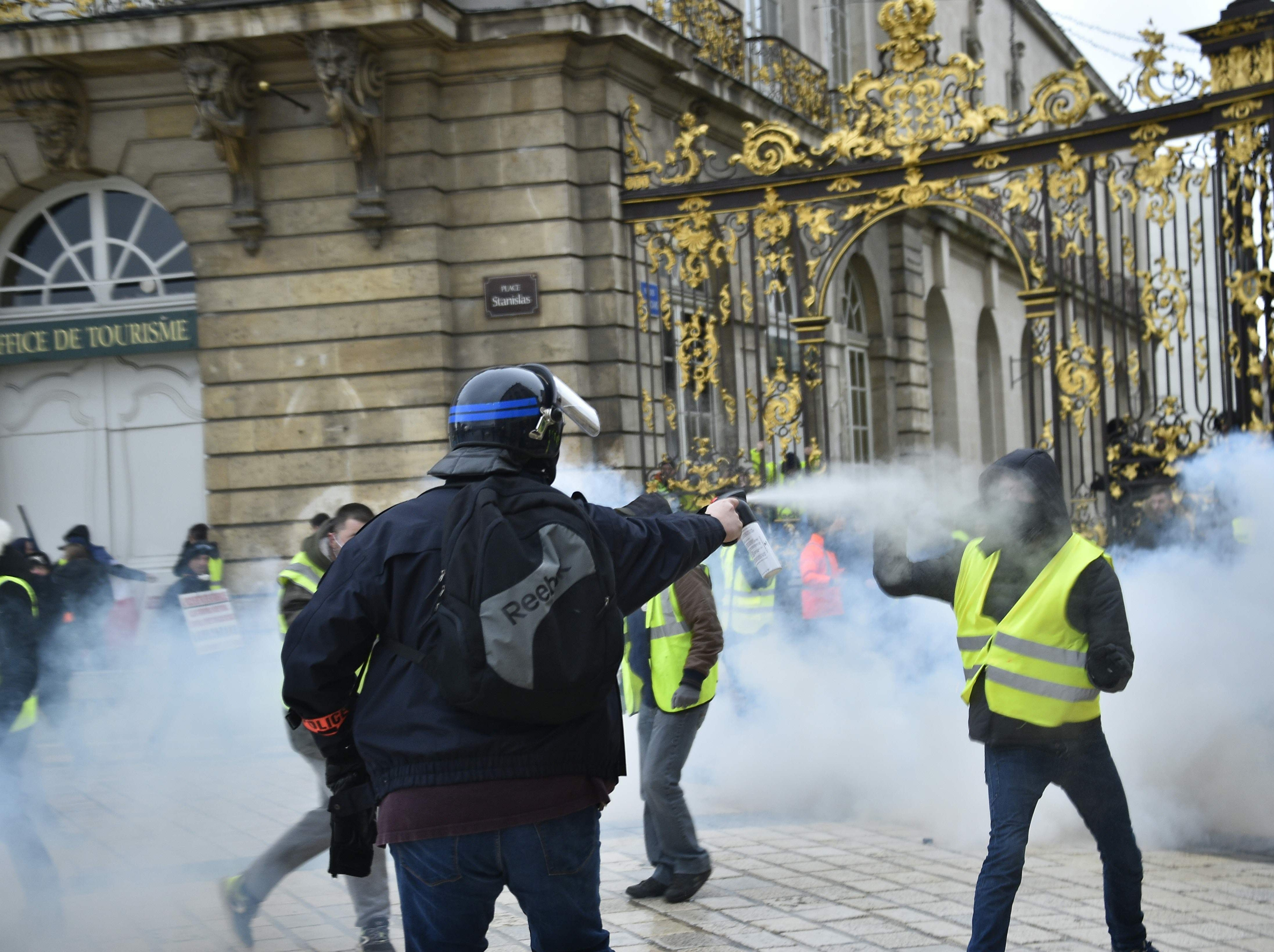 "A plain-clothes policeman uses pepper-spray on a ""Yellow Vest"" protester on Feb. 2, 2019 in Nancy, eastern France, during a march called to pacifically protests against police violence toward participants of the last three months demonstrations in France, as ""Yellow Vest"" protesters take to the streets for the 12th consecutive Saturday."