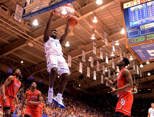 Duke Blue Devils forward Zion Williamson (1) dunks the ball during the second half against the St. John's Red Storm at Cameron Indoor Stadium. The Blue Devils won 91-61.