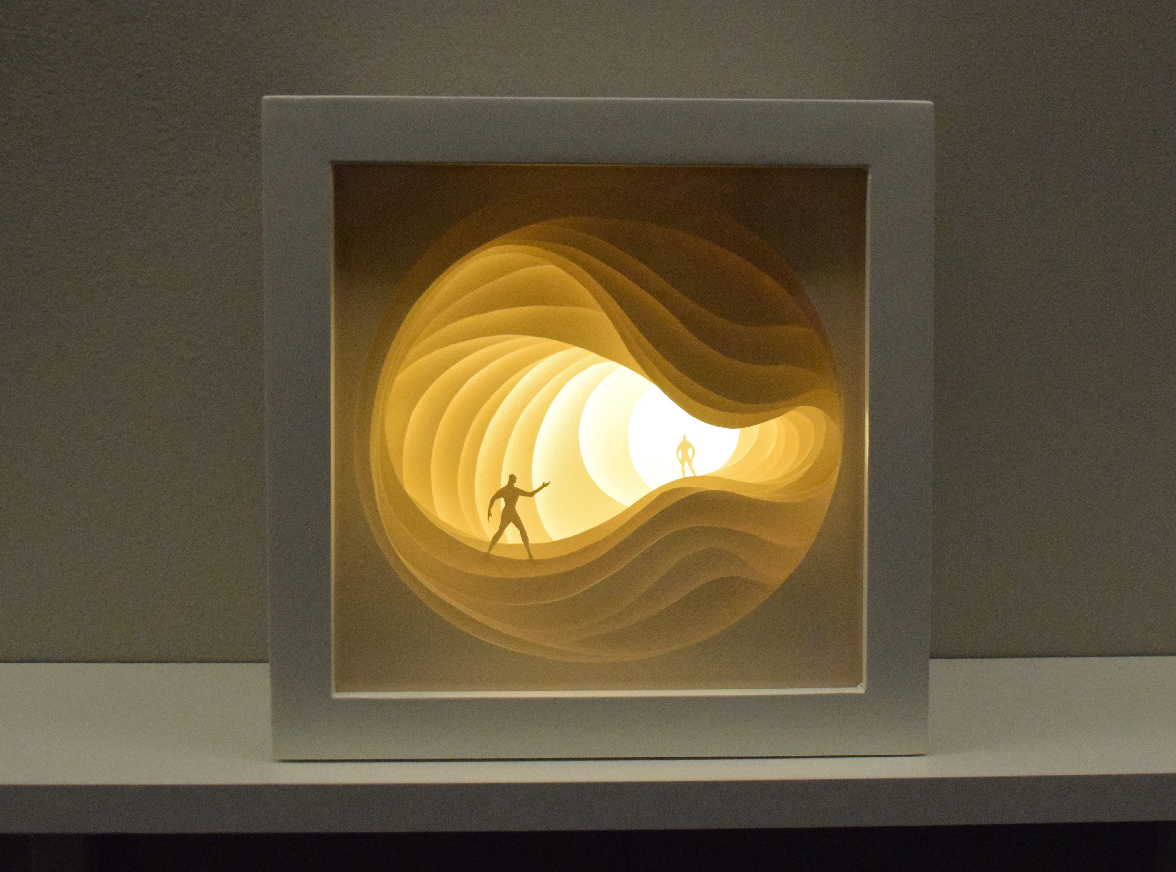 """""""Light by the Forest"""" is a new exhibit on display at the Alexandria Museum of Art through Feb. 16, 2018. The exhibit features the art work of husband and wife artists Hari and Deepti of India. The work consists of cut paper shadow boxes that tell stories. Hari and Deepti are set to travel to Alexandria from India. They will be artists in residence at the museum from Nov. 29-Dec. 11. They will create an installation piece and conduct a workshop for adults in shadow sculpting from 10 a.m. to 3 p.m. on Dec. 1. Visitors are also encouraged to create their own paper light box compostion with figurines provided. They are encouraged to take a photo and upload it to the Alexandria Museum of Art's Facebook page."""