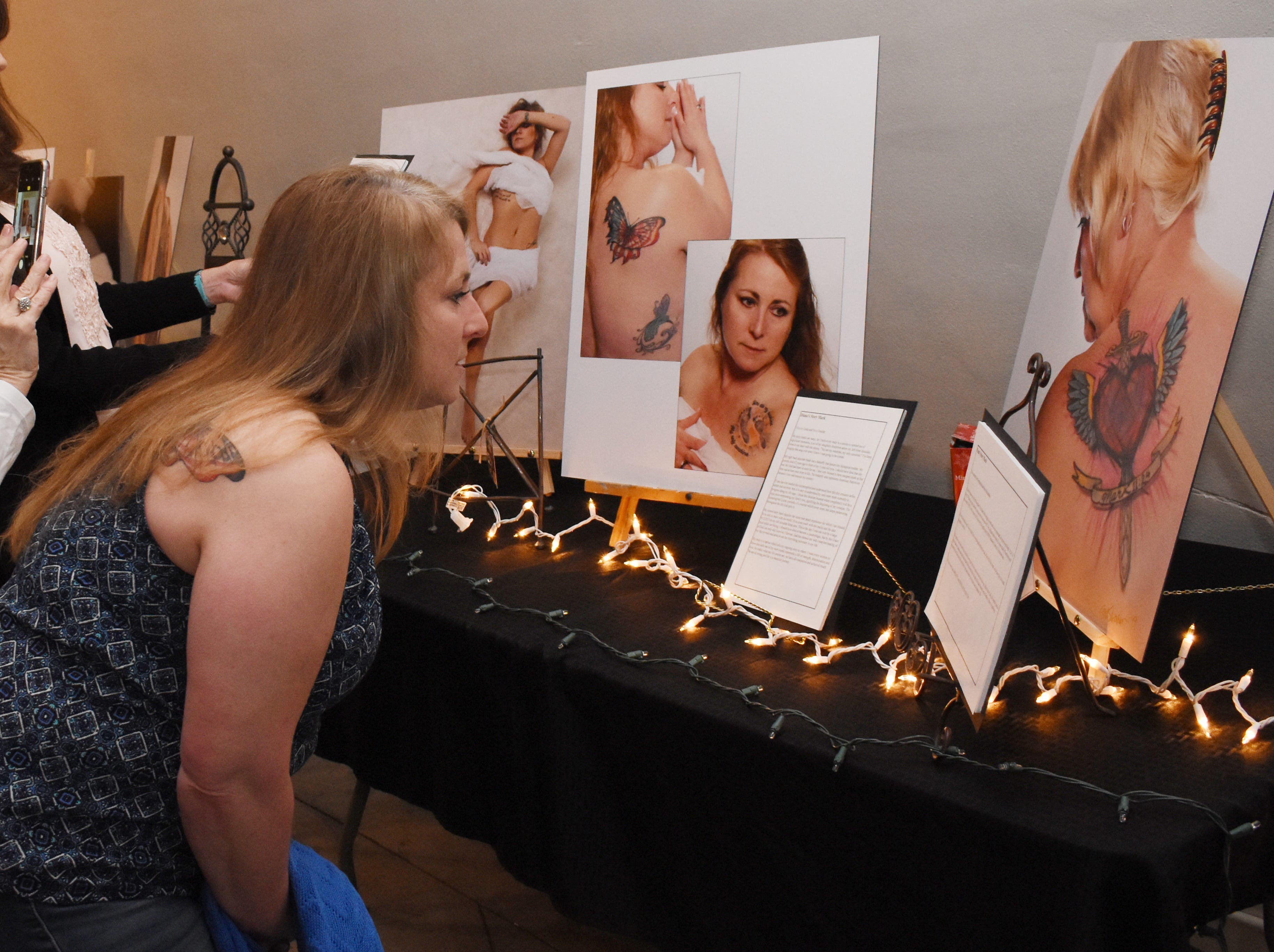 """Diane DeWeese was one of the local women photographed for a project called """"Story Marks."""" An event highlighting the project and women who have tattoos and the stories behind them was held Friday, Feb. 1, 2019 at Willowbench Meeting Place in Pineville.""""We've recruited 18 women and their stories behind their tattoos,"""" said Belle Chatelain, one of the event organizers. Chatelain said Story Marks is a division of Stonecroft, a non-profit ministry. """"These are events that have been around the nation for the last - probably three years,"""" explained Chatelain. """"They've been  in about 30 states. And we're the first to bring one to Louisiana.""""The women and their tattoos were photographed by local photographer Susan Merritt Stevison. The photographs of the women, the tattoos and their stories were on display.""""We've been planning this for months,"""" said Chatelain. The event is about building community, crossing cultural, religious denominations, socioeconomic differences and boundaries, she explained.""""To bring women together because we are a community of women and our message is that your story matters,"""" she added. """"That every woman has a story. We come together and share our stories we'll see how much we have in common versus how much that we're different.""""The event emcee, Wendi Bryant, is leading a community group call Themes at the Rapides Parish Library on Wednesday nights for four weeks to teach women how to write their life story.Molly Townsend dcoumented Friday's event. Tammie Thames, owner of Willowbench, donated the meeting space for the event."""