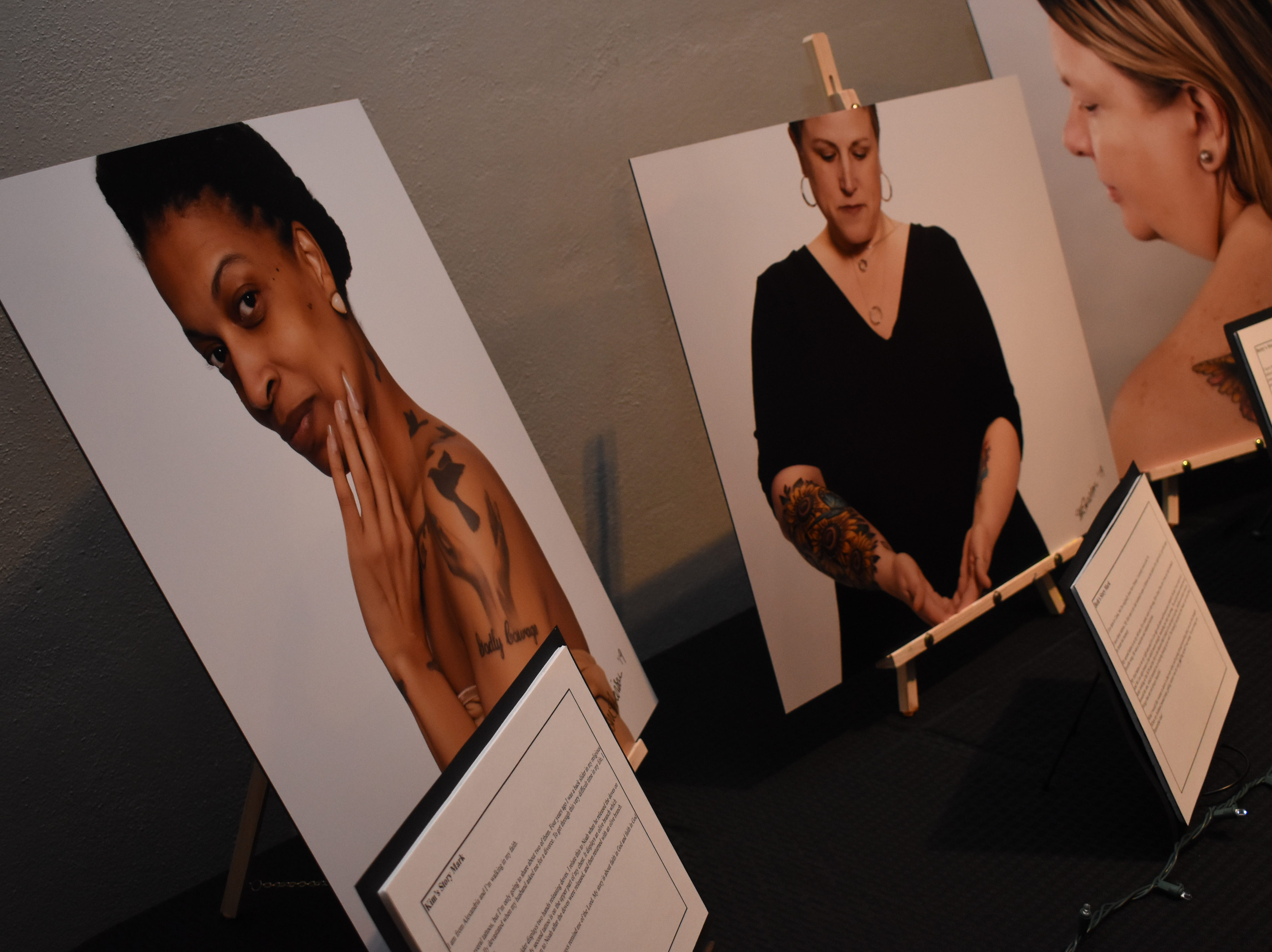 """""""Story Marks,"""" an event highlighting women who have tattoos and the stories behind them was held Friday, Feb. 1, 2019 at Willowbench Meeting Place in Pineville.""""We've recruited 18 women and their stories behind their tattoos,"""" said Belle Chatelain, one of the event organizers. Chatelain said Story Marks is a division of Stonecroft, a non-profit ministry. """"These are events that have been around the nation for the last - probably three years,"""" explained Chatelain. """"They've been  in about 30 states. And we're the first to bring one to Louisiana.""""The women and their tattoos were photographed by local photographer Susan Merritt Stevison. The photographs of the women, the tattoos and their stories were on display.""""We've been planning this for months,"""" said Chatelain. The event is about building community, crossing cultural, religious denominations, socioeconomic differences and boundaries, she explained.""""To bring women together because we are a community of women and our message is that your story matters,"""" she added. """"That every woman has a story. We come together and share our stories we'll see how much we have in common versus how much that we're different.""""The event emcee, Wendi Bryant, is leading a community group call Themes at the Rapides Parish Library on Wednesday nights for four weeks to teach women how to write their life story.Molly Townsend dcoumented Friday's event. Tammie Thames, owner of Willowbench, donated the meeting space for the event."""