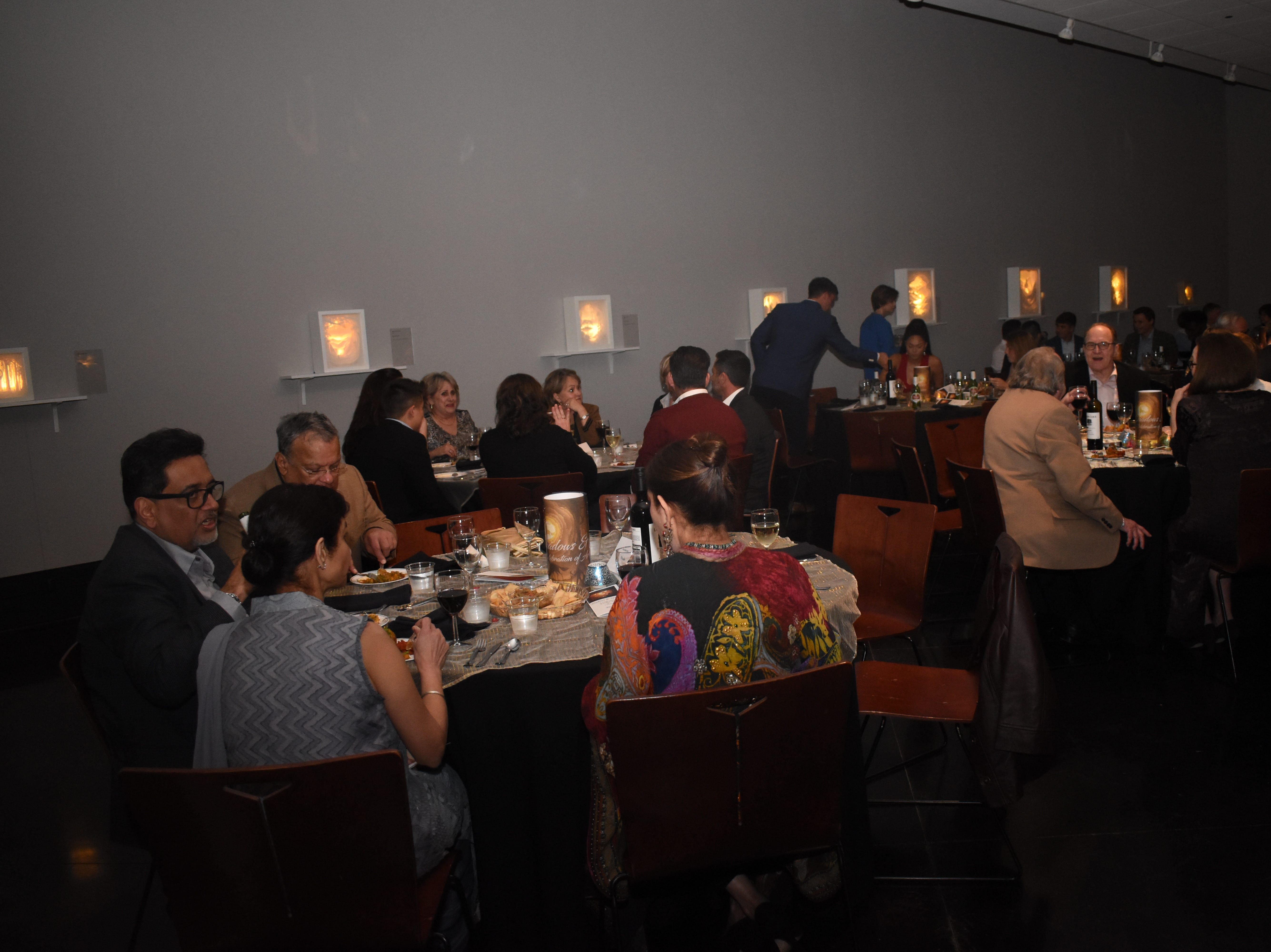 """""""Shadows and Spices: A Celebration of Art and Cuisine"""" was held at the Alexandria Museum of Art Saturday, Feb. 2, 2019. The museum is exhibiting """"Light by the Forest"""" by Indian artists Hari & Deepti who are husband and wife. An Indian dinner was sponsored by Dr. Sudha and Amy Pillarisetti."""
