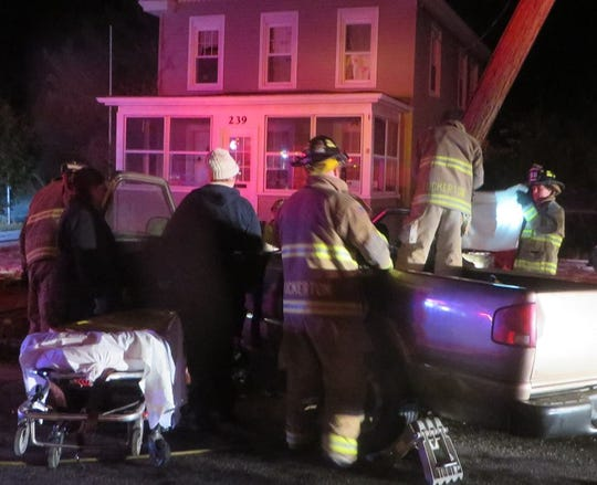 Tuckerton Fire and EMS crews work to free an injured passenger from a truck that was mangled in a car accident early this morning.