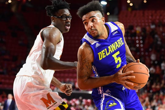 Delaware Fightin Blue Hens forward Eric Carter (5) makes a move to the basket as Maryland Terrapins forward Jalen Smith (25)