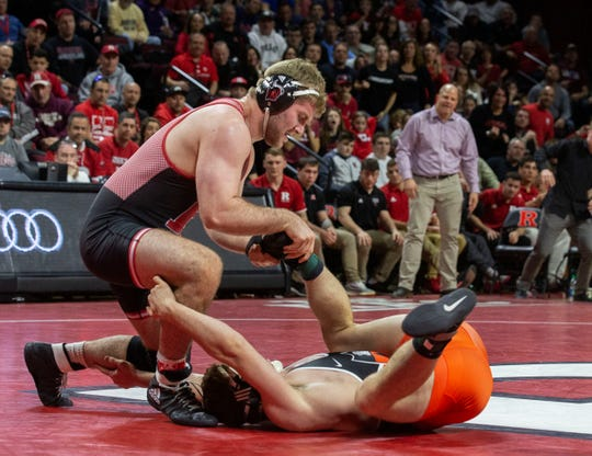Rutgers' heavyweight Christian Colucci recorded a major decision over Kendall Elfstrum in the final bout to give Rutgers a dramatic 19-18 win over Princeton Sunday in a classic match between the two New Jersey schools.