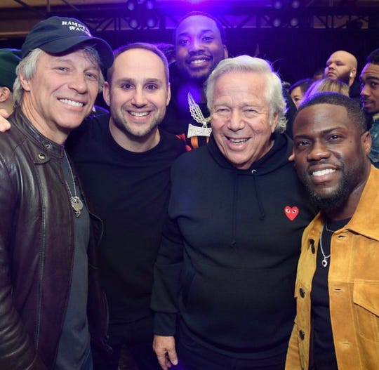 Jon Bon Jovi, Michael Rubin, Robert Kraft   and Kevin Hart, with Meek Mill in hte background, at the Fanatics Super Bowl party Feb. 2, 2019 in Atlanta