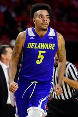 Delaware forward Eric Carter (5) reacts after scoring during the second half against the Maryland Terrapins
