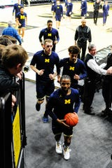 Michigan Wolverines leave the court at Carver-Hawkeye Arena before the game against the Iowa Hawkeyes.