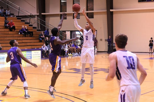 HSU senior Joe Hoeup (2) takes a 3-point shot against Mary Hardin-Baylor on Saturday afternoon. Hoeup scored a game-high 37 points in his final game at the Mabee Complex.