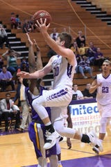 HSU senior Ryan Chaney (10) scores and gets fouled against Mary Hardin-Baylor on Saturday afternoon. Chaney completed the three-point play on Senior Day, his final home game at the Mabee Complex.