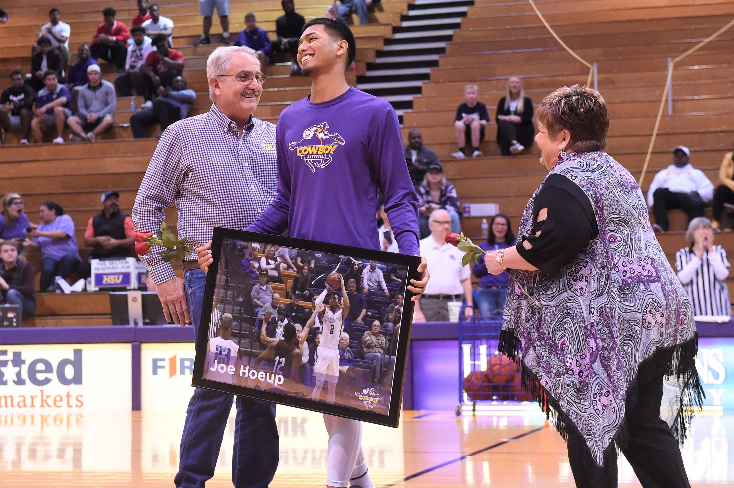 Hardin-Simmons senior guard Joe Hoeup, middle, reacts to hearing his mom and family was flown in from California for Saturday's Senior Day game at the Mabee Complex.