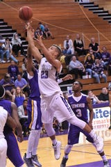 HSU senior Jalen Terry (23) floats a shot over a Mary Hardin-Baylor defender on Saturday afternoon. Terry scored 17 points on Senior Day.