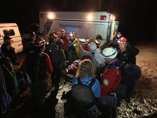 Crews ready a climber for transport to Transylvania Regional Hospital after the climber, along with another, was rescued from Looking Glass Rock in Pisgah National Forest on Feb. 2, 2019.
