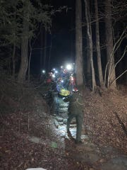 Rescue crews bring a climber down from Looking Glass Rock in Pisgah National Forest on Feb. 2, 2019. Two climbers were rescued and airlifted to Mission Hospital in Asheville.