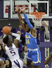 Washington guard Jaylen Nowell (5) shoots against UCLA guard Jalen Hill (24) during the first half of an NCAA college basketball game, Saturday, Feb. 2, 2019, in Seattle. (AP Photo/Ted S. Warren)