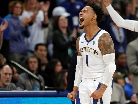 Washington guard David Crisp celebrates near the end of the second half of an NCAA college basketball game against UCLA, Saturday, Feb. 2, 2019, in Seattle. Washington won 69-55. (AP Photo/Ted S. Warren)