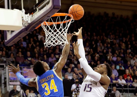 Washington forward Noah Dickerson (15) shoots against UCLA guard David Singleton (34) during the first half of an NCAA college basketball game, Saturday, Feb. 2, 2019, in Seattle. (AP Photo/Ted S. Warren)