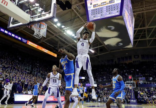 cWashington guard Matisse Thybulle (4) graves a rebound above UCLA forward Cody Riley (2) during the first half of an NCAA college basketball game, Saturday, Feb. 2, 2019, in Seattle. Washington won 69-55. (AP Photo/Ted S. Warren)