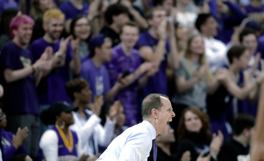 Washington coach Mike Hopkins reacts as people in the student section cheer during the second half of the team's NCAA college basketball game against UCLA, Saturday, Feb. 2, 2019, in Seattle. Washington won 69-55. (AP Photo/Ted S. Warren)