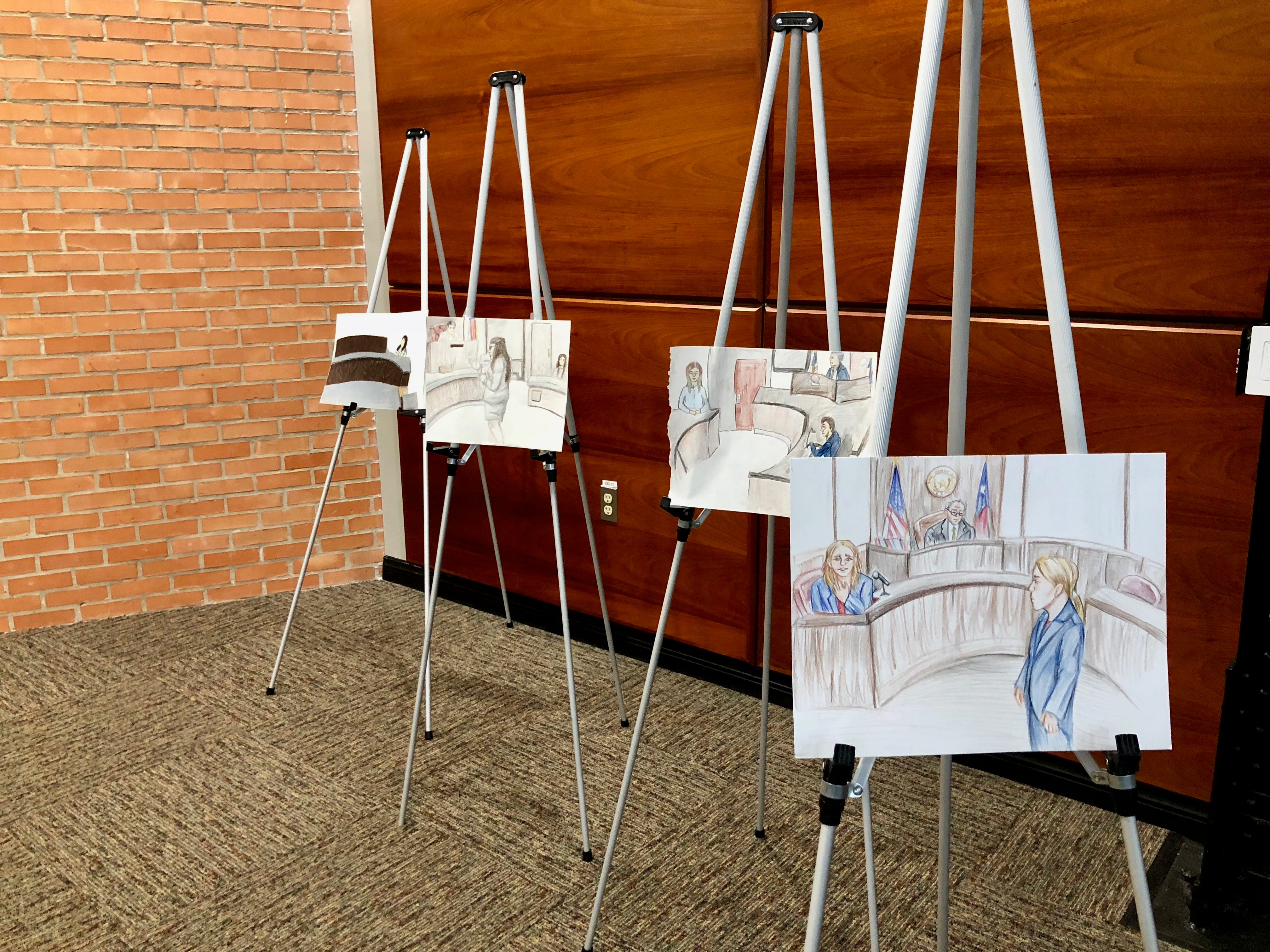 Sketches by student courtroom artists are displayed at a dinner following the 2019 mock trial competition.