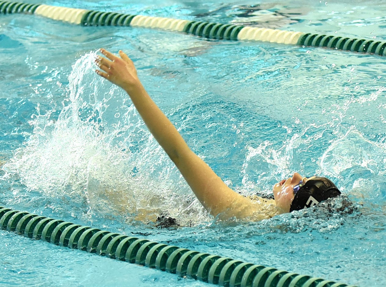 Hannah Cech of Lakota East swims the backstroke leg in the girls 200-yard individual medley at the 2019 Greater Miami Conference swimming championships, Feb. 2, 2019.