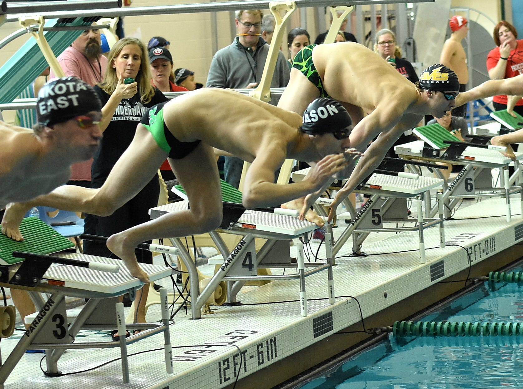 The platforms were loaded with swimmers from Sycamore and Mason for the final heat of the boys 200-yard individual medley at the 2019 Greater Miami Conference swimming championships, Feb. 2, 2019.