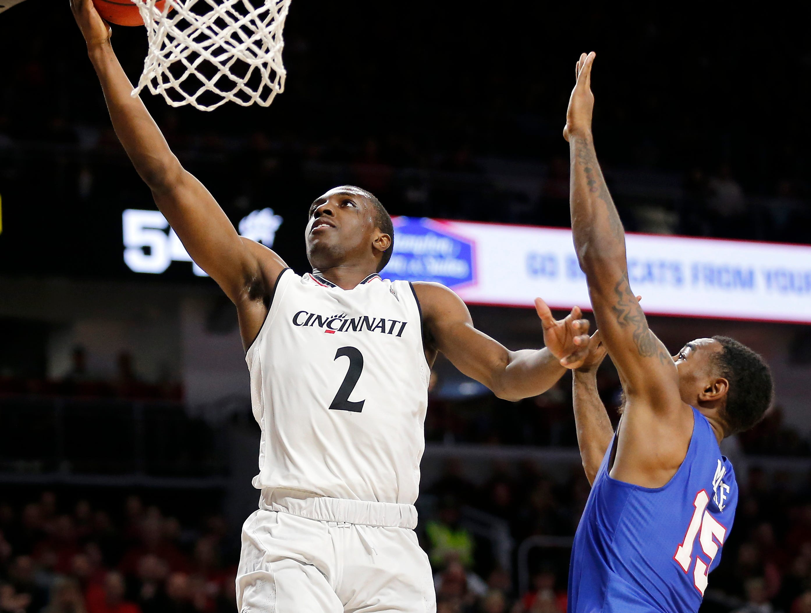 Cincinnati Bearcats guard Keith Williams (2) puts in a layup over Southern Methodist Mustangs forward Isiaha Mike (15) in the second half the the NCAA American Athletic Conference basketball game between the Cincinnati Bearcats and the Southern Methodist Mustangs at Fifth Third Arena in Cincinnati on Saturday, Feb. 2, 2019. The Bearcats edged out SMU for a 73-68 win.