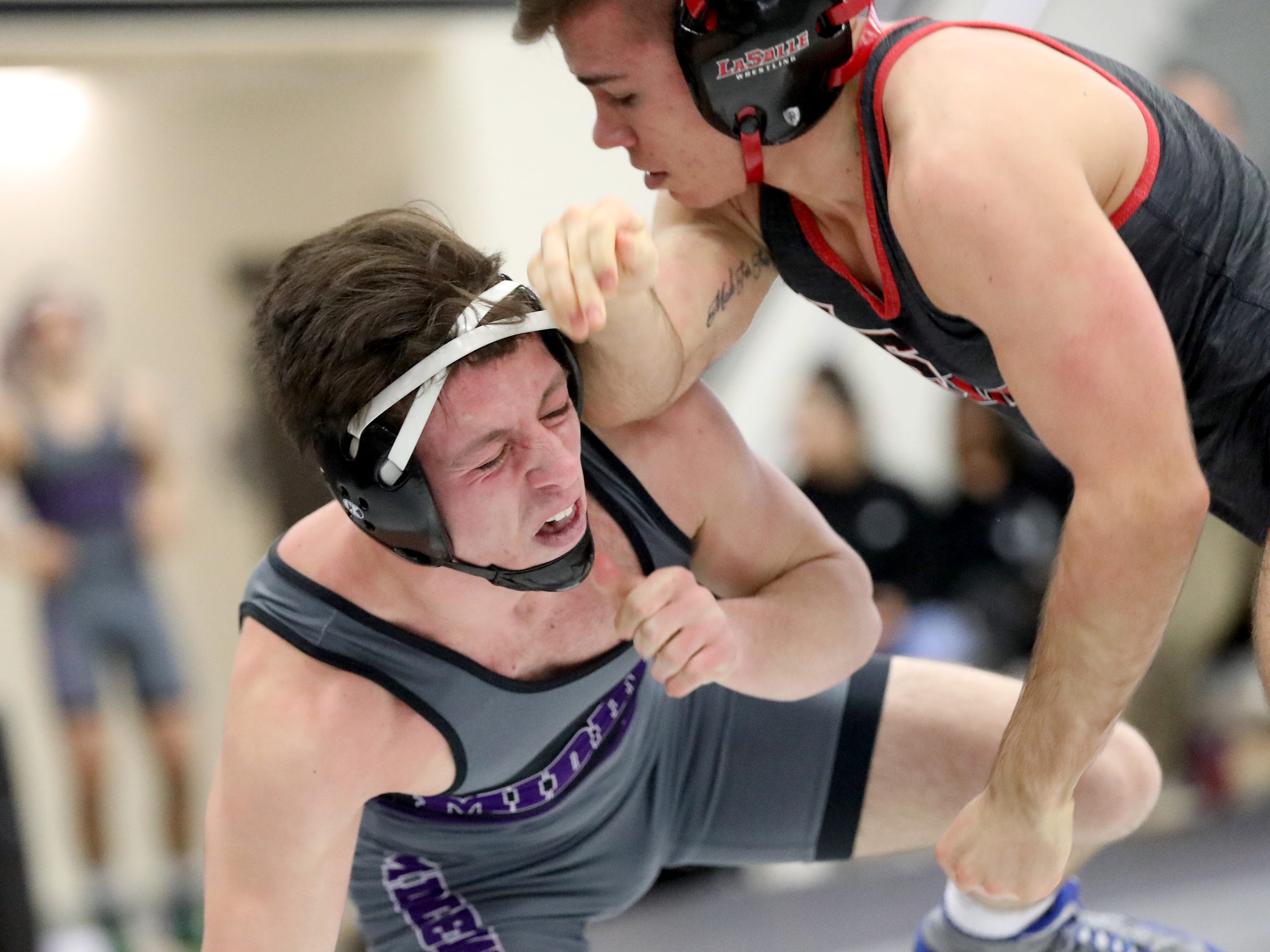 La Salle wrestler Jake Niffenegger, right, battles Middletown wrestler Aundre Zornes during the Division I team tournament at Lakota East High School, Saturday, Feb. 2, 2019.