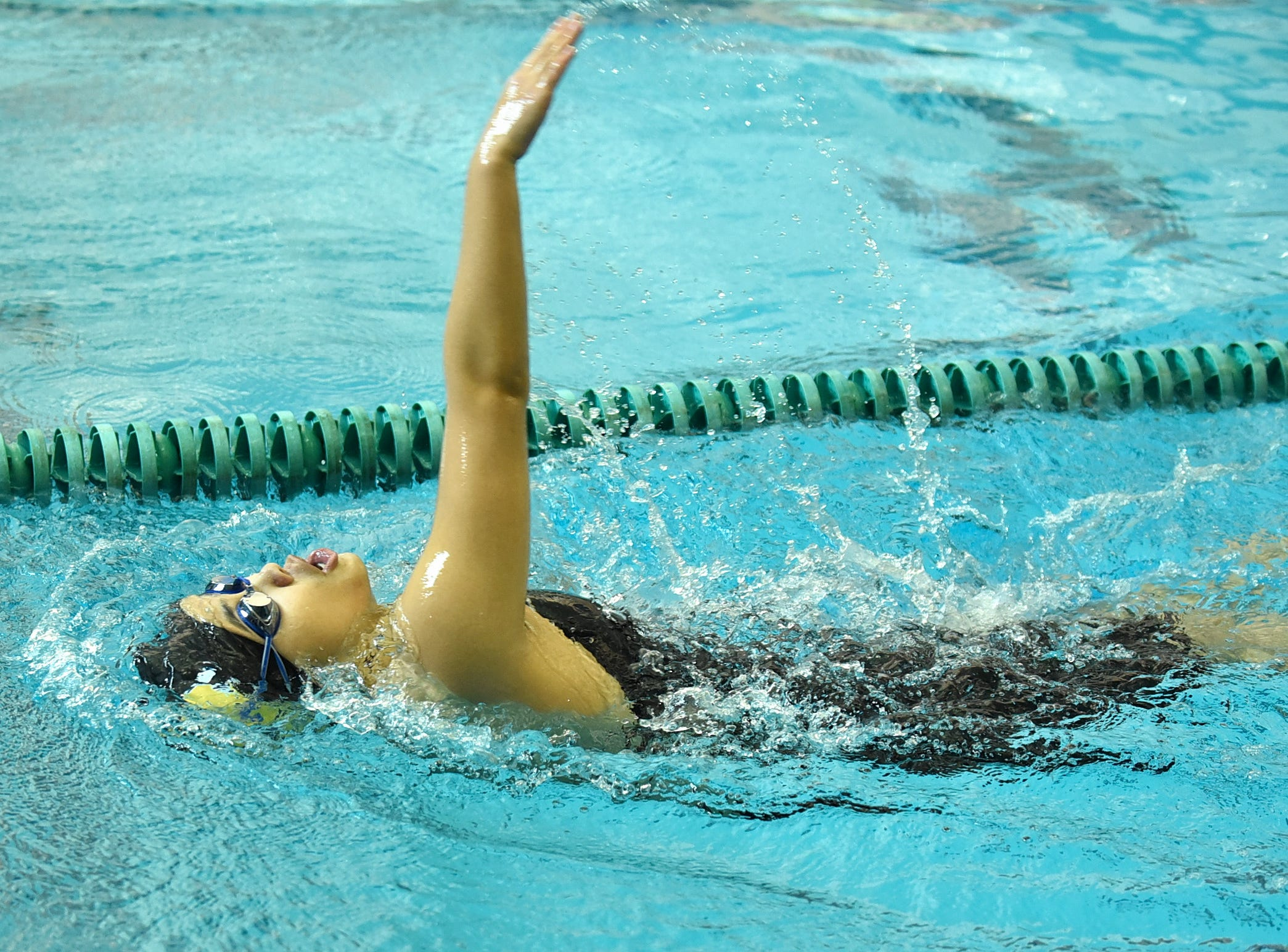 Deeya Prakash of Sycamore swims through the backstroke in the girls 200-yard individual medley at the 2019 Greater Miami Conference swimming championships, Feb. 2, 2019.