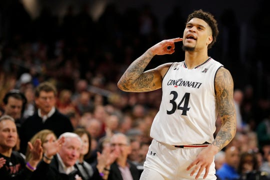 Cincinnati Bearcats guard Jarron Cumberland (34) celebrates after sinking a three point shot in the first half the the NCAA American Athletic Conference basketball game between the Cincinnati Bearcats and the Southern Methodist Mustangs at Fifth Third Arena in Cincinnati on Saturday, Feb. 2, 2019.