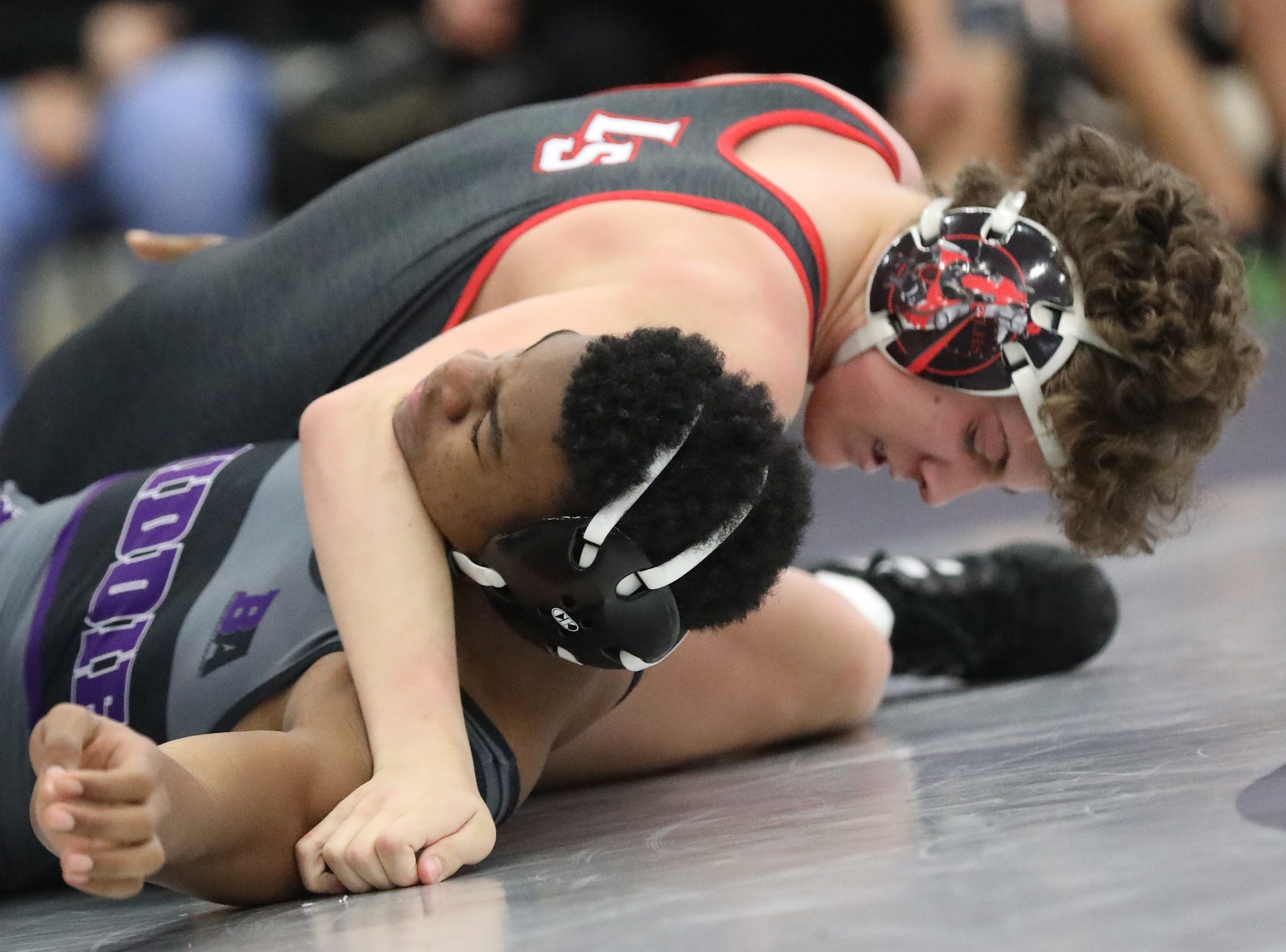 La Salle wrestler Chase Stein battles Middletown wrestler Terrecc Richardson during the Division I team tournament at Lakota East High School, Saturday, Feb. 2, 2019.