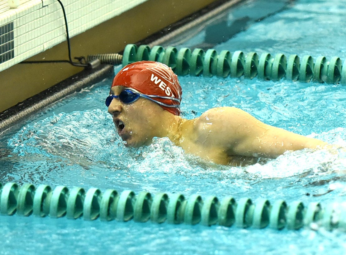 Michael Lorenz of Lakota West touches the wall first in the third heat of the boys 200-yard freestyle at the 2019 Greater Miami Conference swimming championships, Feb. 2, 2019.