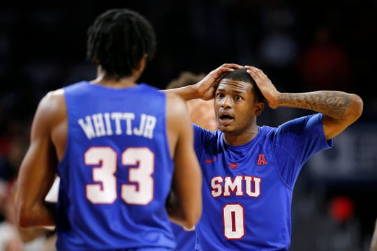Southern Methodist Mustangs guard Jahmal McMurray (0) reacts after SMU turns over the ball late in the second half the the NCAA American Athletic Conference basketball game between the Cincinnati Bearcats and the Southern Methodist Mustangs at Fifth Third Arena in Cincinnati on Sunday, Feb. 3, 2019. The Bearcats edged out SMU for a 73-68 win.