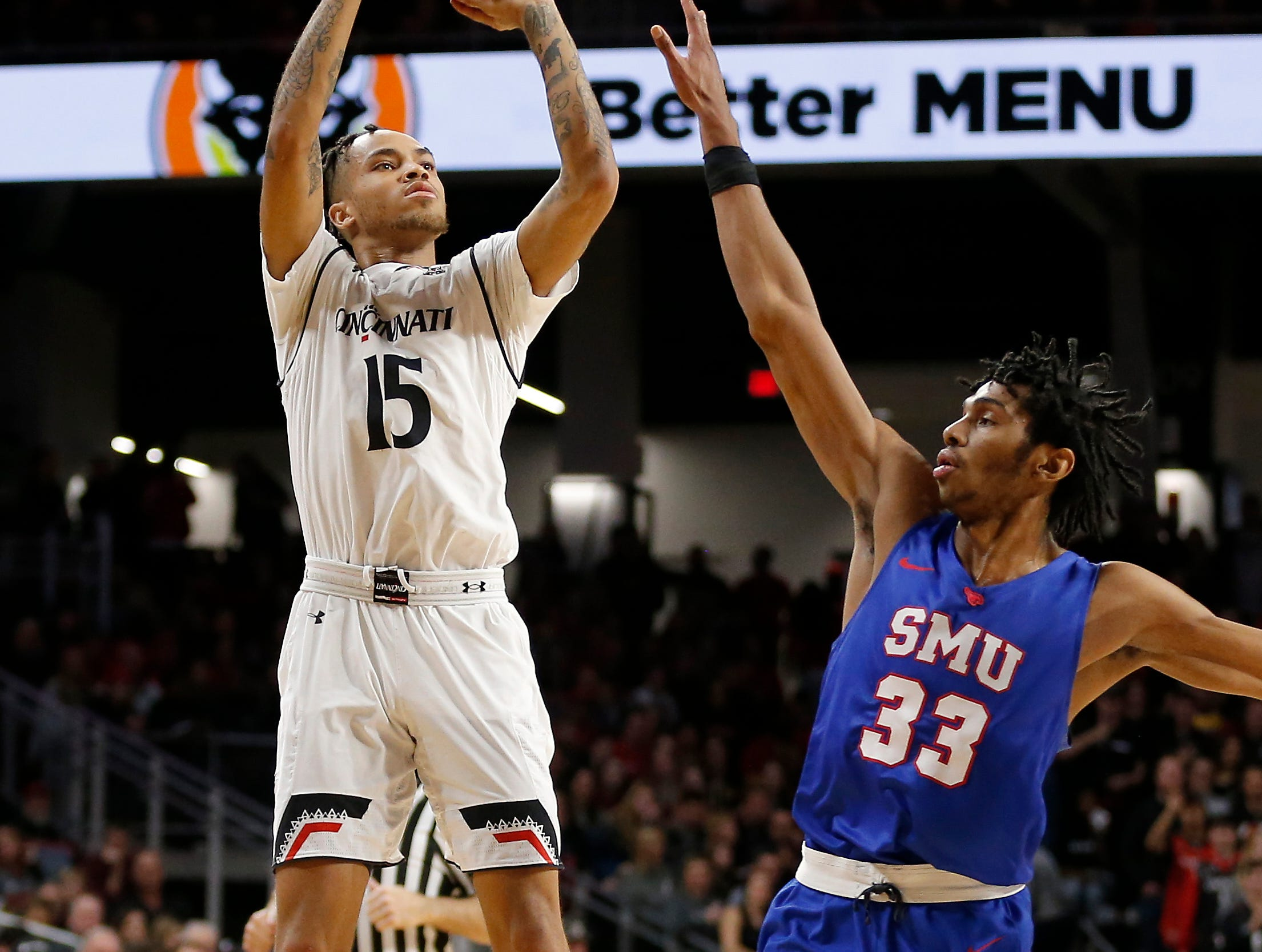 Cincinnati Bearcats guard Cane Broome (15) shoots from three point range in the first half the the NCAA American Athletic Conference basketball game between the Cincinnati Bearcats and the Southern Methodist Mustangs at Fifth Third Arena in Cincinnati on Saturday, Feb. 2, 2019.