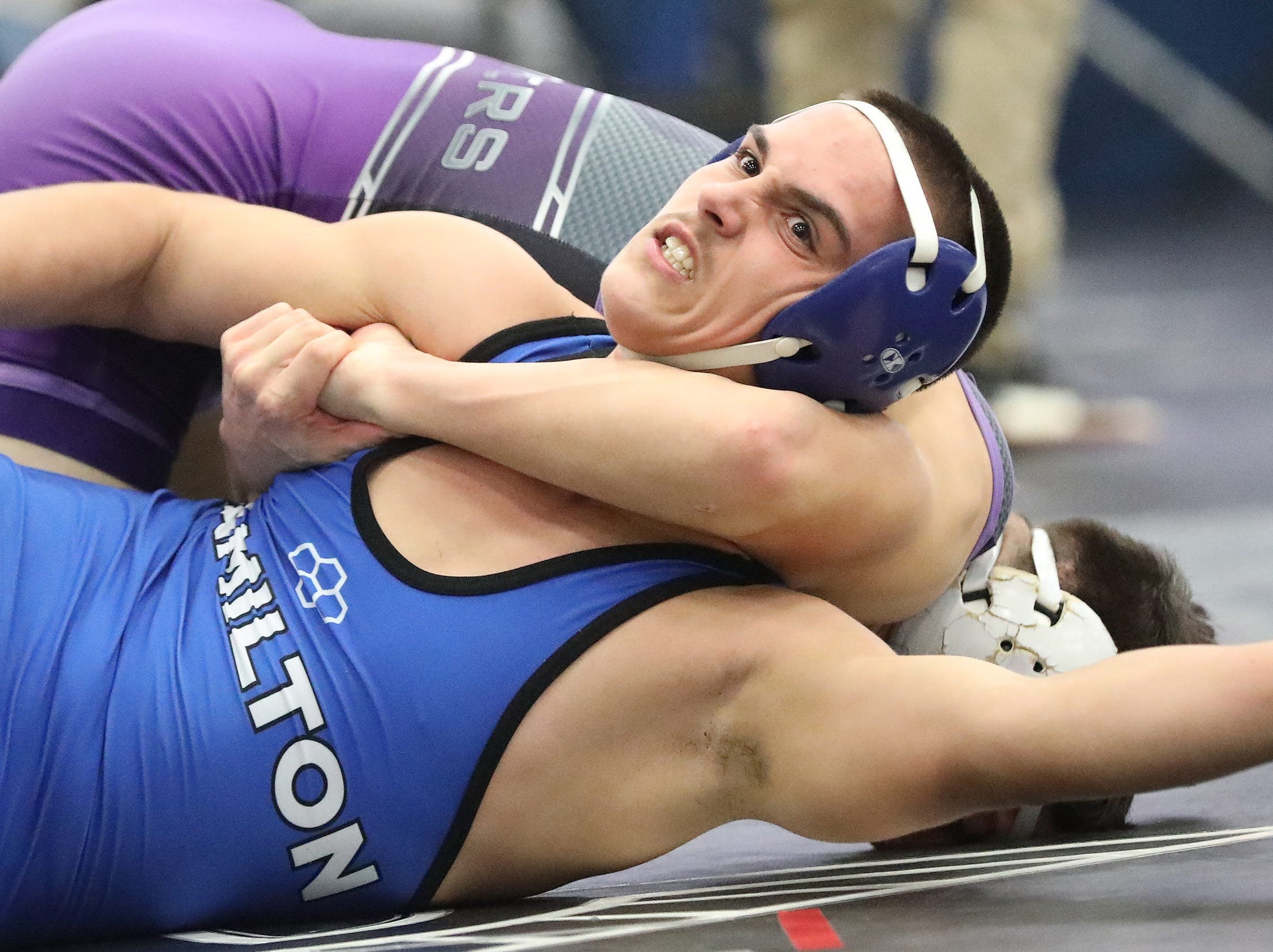 Hamilton wrestler Dylan Deck battles Elder wrestler D.J. Meillo during the Division I team tournament at Lakota East High School, Saturday, Feb. 2,2019.