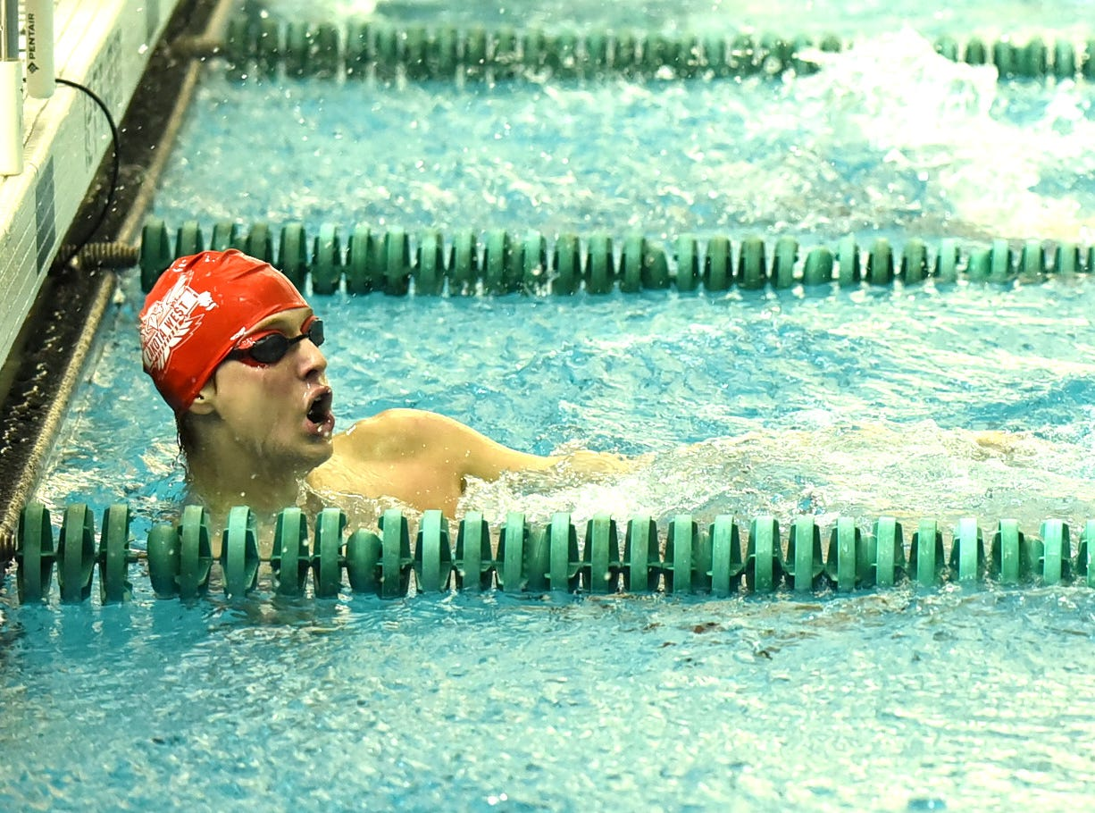 Michael Lorenz of Lakota West takes home first place in the boys 100-yard backstroke at the 2019 Greater Miami Conference swimming championships, Feb. 2, 2019.