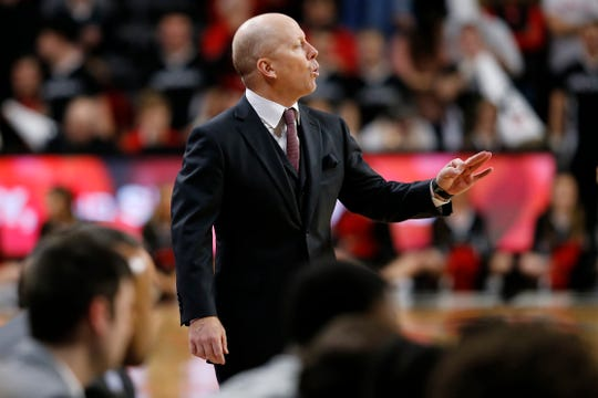 Cincinnati Bearcats head coach Mick Cronin directs his offense in the second half the the NCAA American Athletic Conference basketball game between the Cincinnati Bearcats and the Southern Methodist Mustangs at Fifth Third Arena in Cincinnati on Saturday, Feb. 2, 2019. The Bearcats edged out SMU for a 73-68 win.