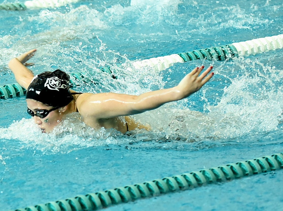Mason's Harna Minezawa buttoned up first place in the girls 100-yard butterfly at the 2019 Greater Miami Conference swimming championships, Feb. 2, 2019.
