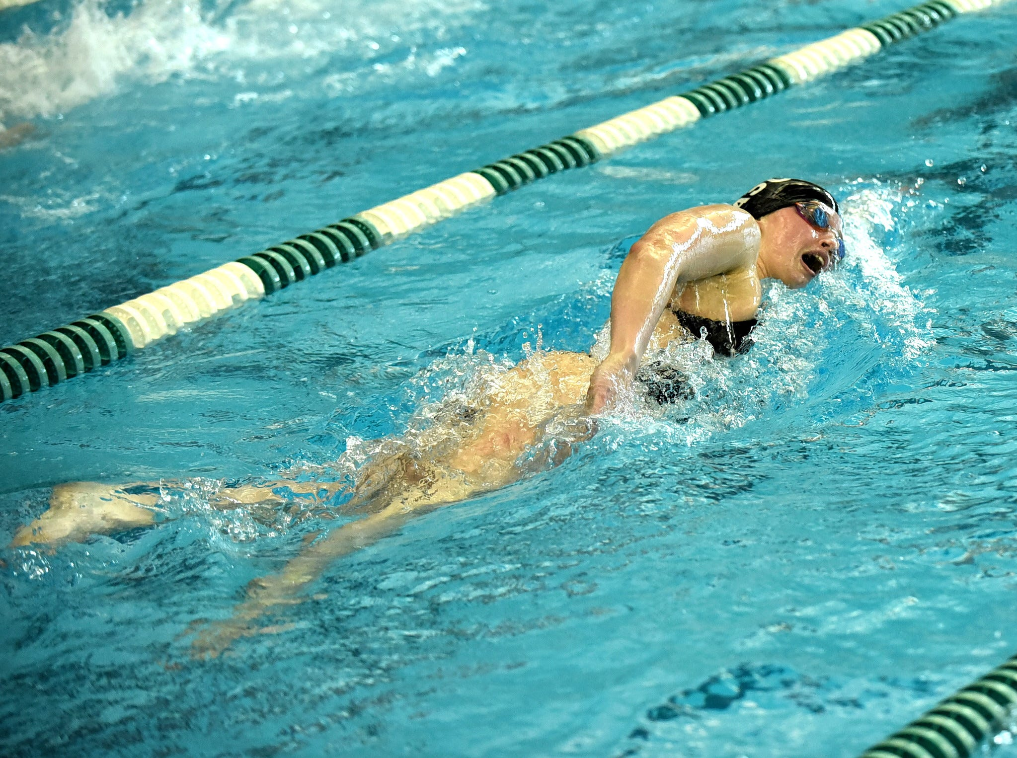 Leanna Wall of Mason swims to a first place finish in the girls 200-yard freestyle at the 2019 Greater Miami Conference swimming championships, Feb. 2, 2019.