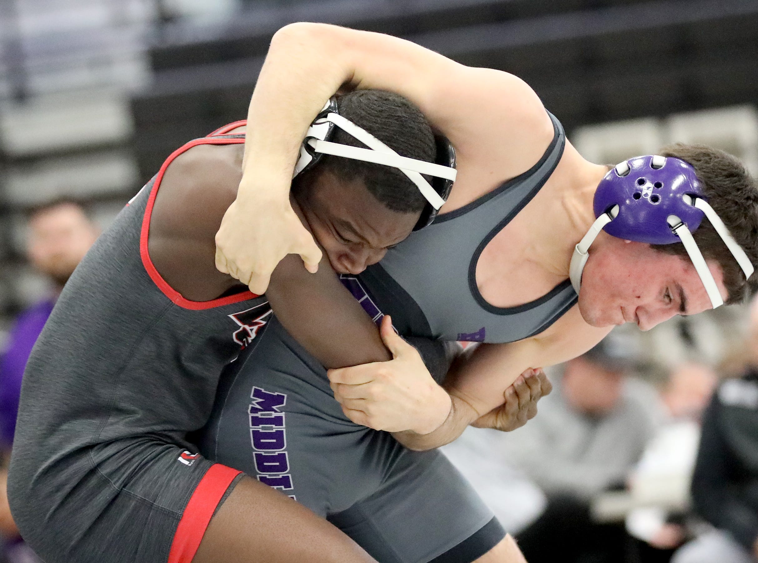 La Salle wrestler Darnai Heard battles Middletown wrestler Judah Thomas during the Division I team tournament at Lakota East High School, Saturday, Feb. 2, 2019.