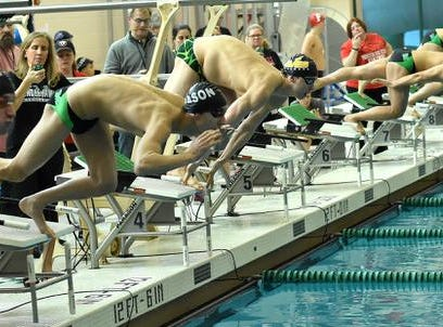 The platforms were loaded with swimmers from Sycamore and Mason for the final heat of the Boys 200 Yard IM at the 2019 GMC Swimming Championships, February 2, 2019.