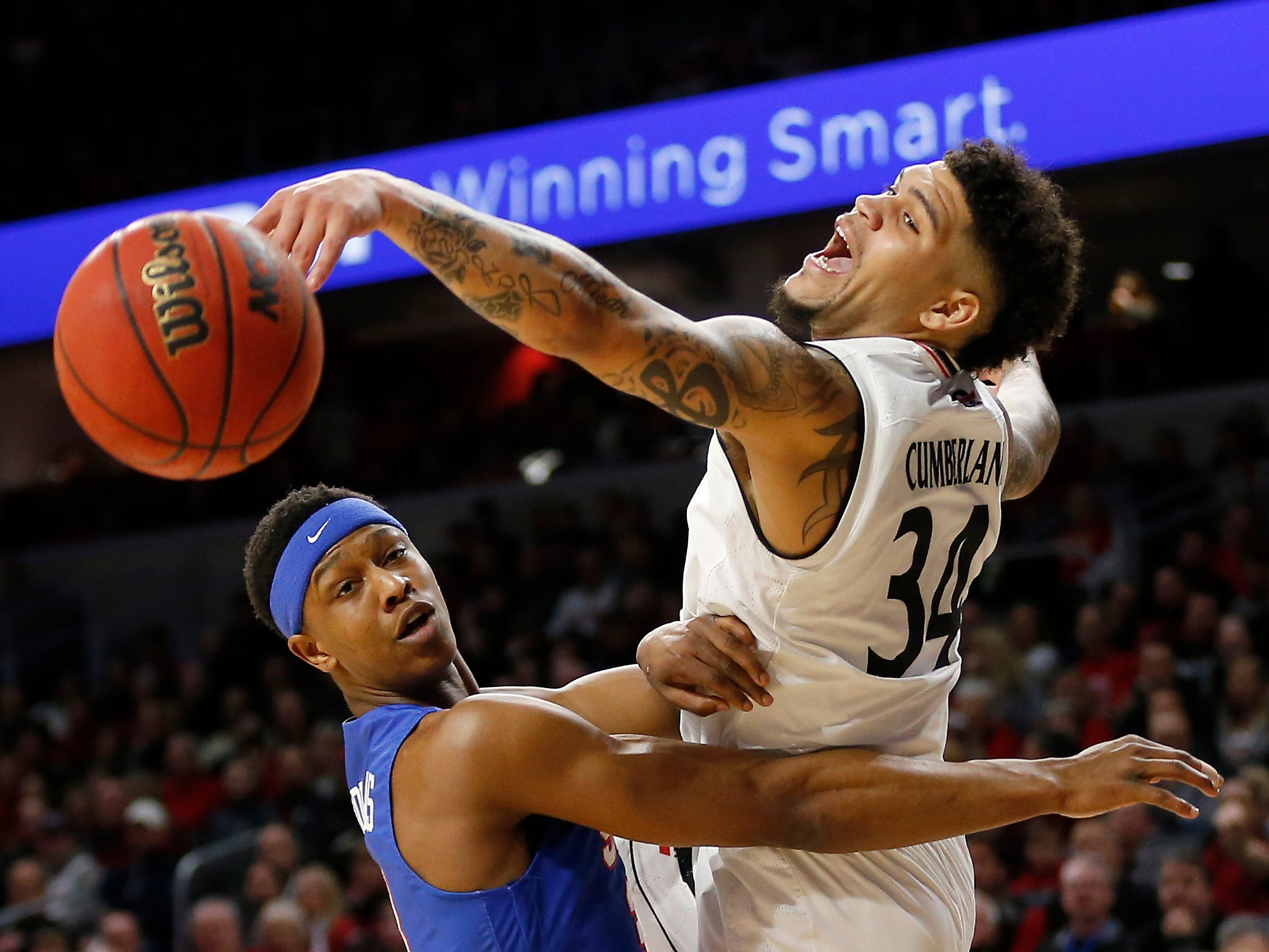 Cincinnati Bearcats guard Jarron Cumberland (34) attempts to knock down an arrant pass in the first half the the NCAA American Athletic Conference basketball game between the Cincinnati Bearcats and the Southern Methodist Mustangs at Fifth Third Arena in Cincinnati on Saturday, Feb. 2, 2019.