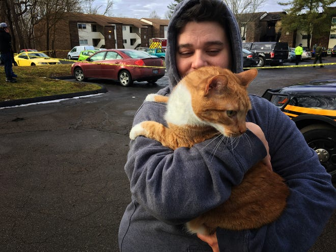 Kim Turner holds Bobo, her cat, who went missing following the police standoff at Royal Oaks Apartments and subsequent fire. It's the same standoff where Clermont County Sheriff's deputy Bill Brewer was killed and Lt. Nick DeRose was injured.
