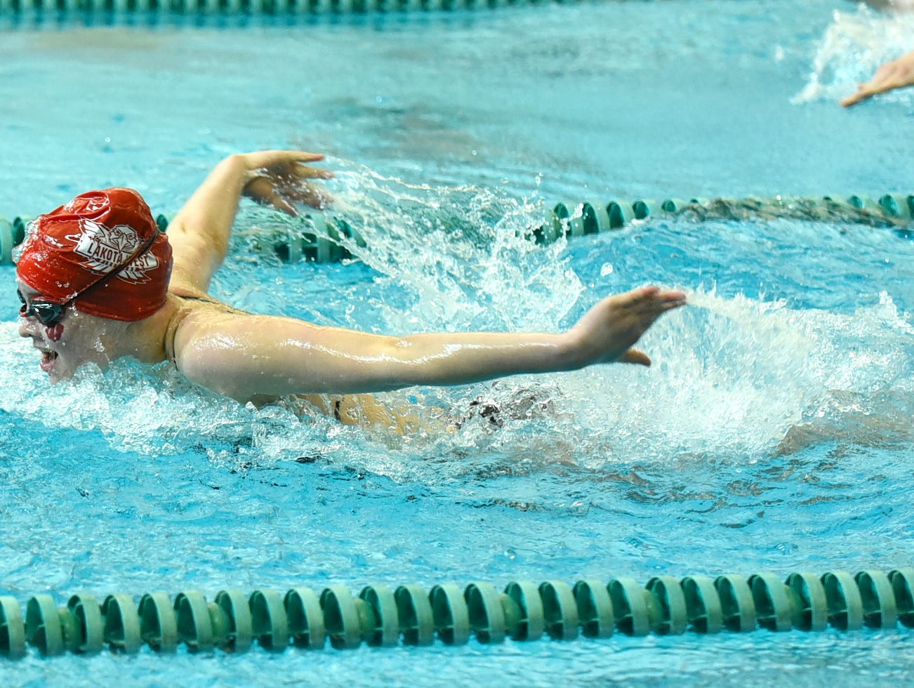 Morgan Allison of Lakota West pumps out the butterfly in the girls 200-yard individual medley at the 2019 Greater Miami Conference swimming championships, Feb. 2, 2019.