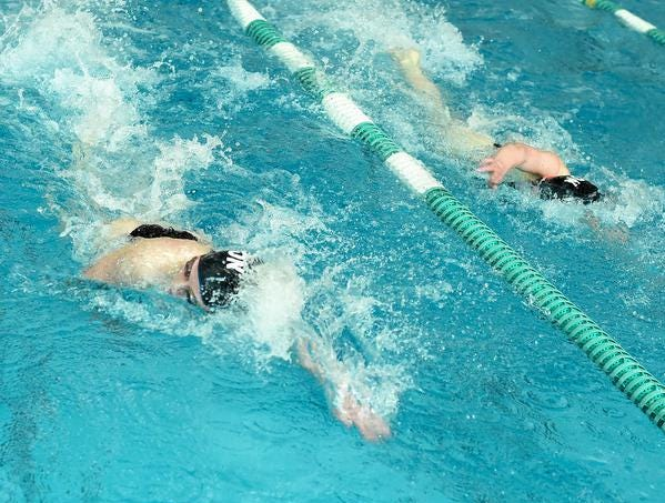 Leanna Wall and Ashley Lugbill of Mason swim to a first and third place finish respectively in the Girls 500 Yard Freestyle at the 2019 GMC Swimming Championships, February 2, 2019.