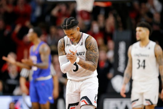 Cincinnati Bearcats guard Justin Jenifer (3) claps his hands as the Bearcats extend a lead in the second half the the NCAA American Athletic Conference basketball game between the Cincinnati Bearcats and the Southern Methodist Mustangs at Fifth Third Arena in Cincinnati on Sunday, Feb. 3, 2019. The Bearcats edged out SMU for a 73-68 win.