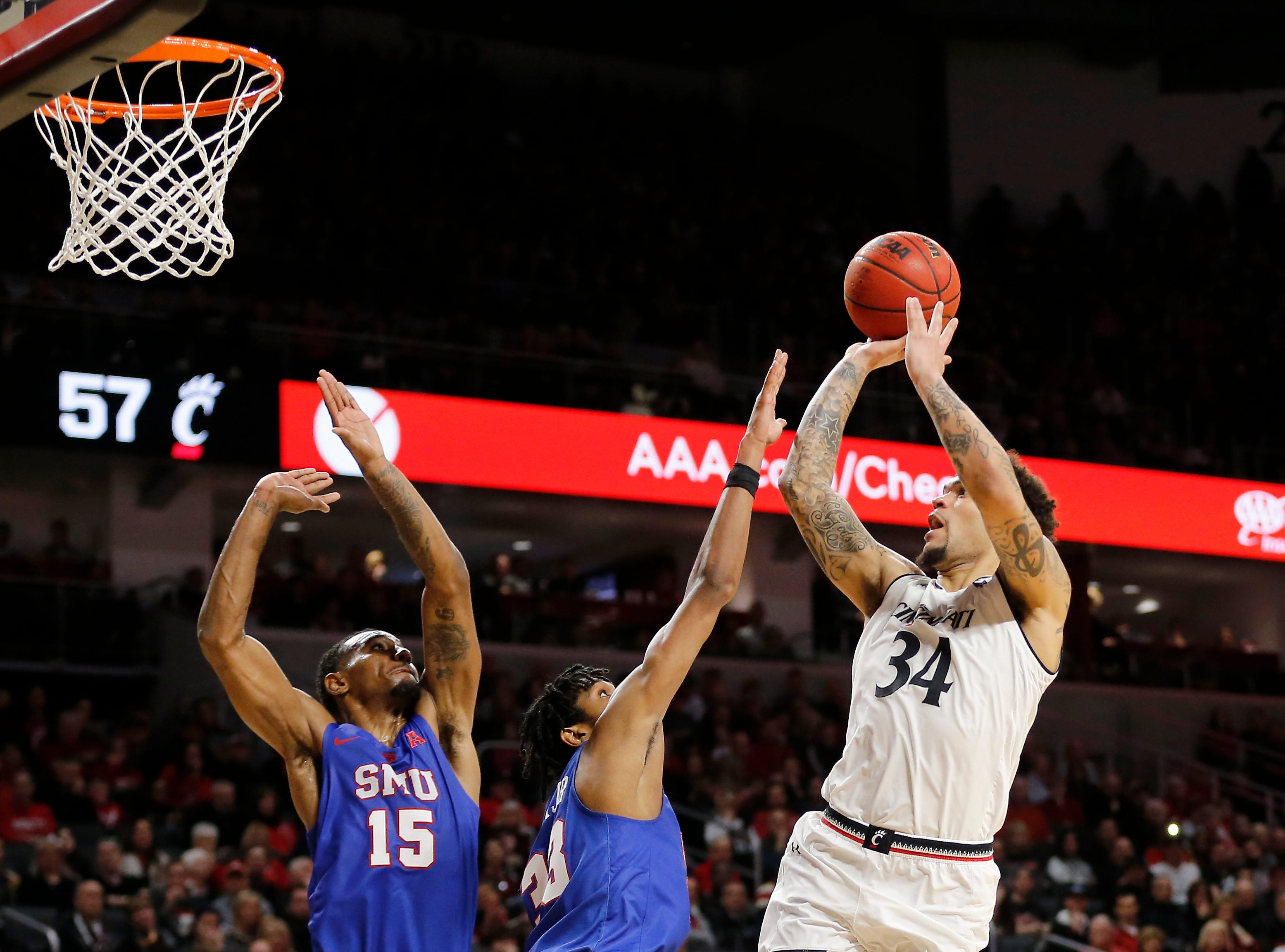 Cincinnati Bearcats guard Jarron Cumberland (34) floats a shot in the second half the the NCAA American Athletic Conference basketball game between the Cincinnati Bearcats and the Southern Methodist Mustangs at Fifth Third Arena in Cincinnati on Saturday, Feb. 2, 2019. The Bearcats edged out SMU for a 73-68 win.